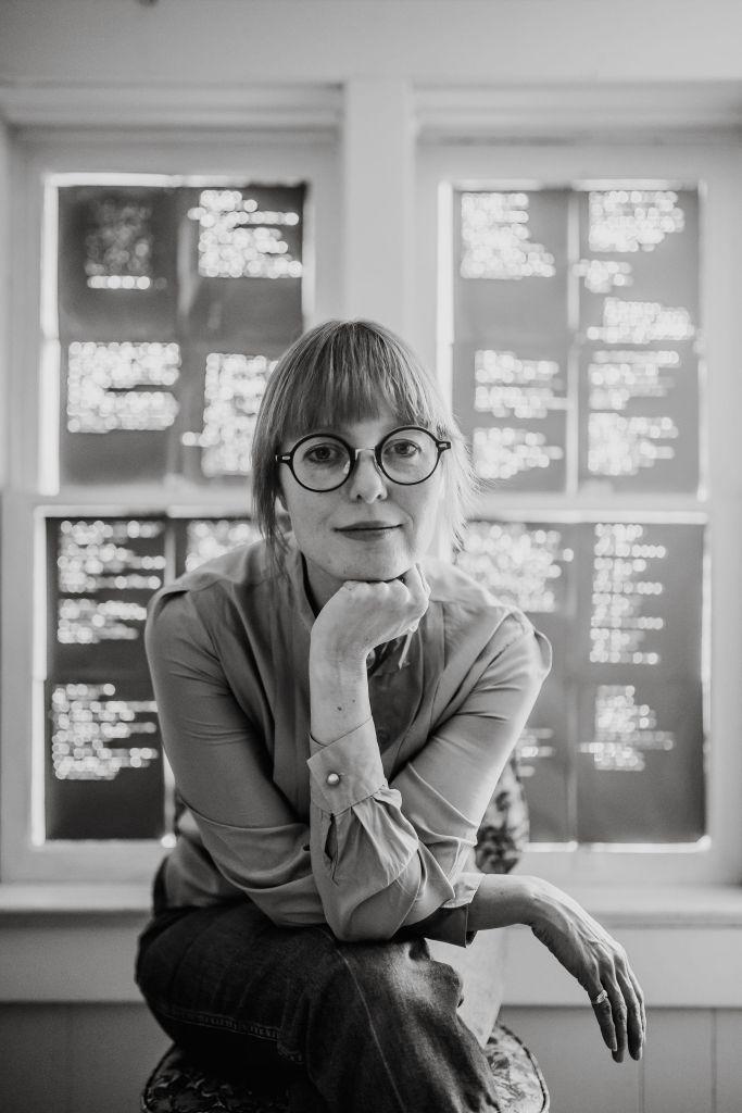 A black and white portrait photo of Jennifer Still